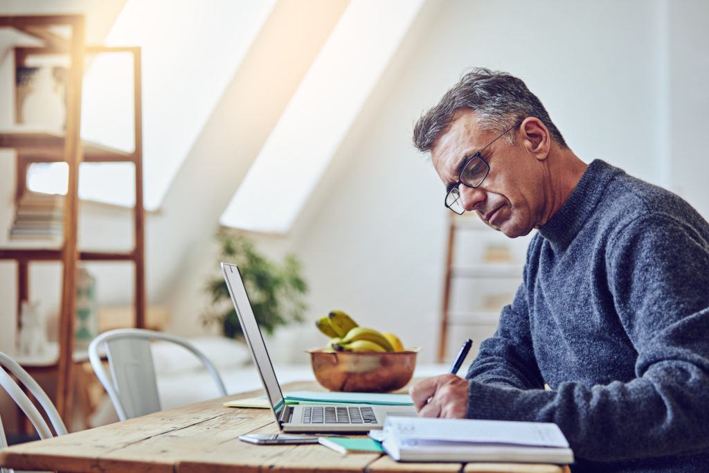 Remote Worker Using Laptop at Home